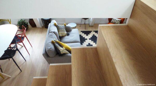 Atelier Sylvie Cahen Architecte Intérieur Paris 12 éme choisy paris pratique fonctionnel design contemporain tendance escalier bois parquet canapé gris fauteuil Kartell