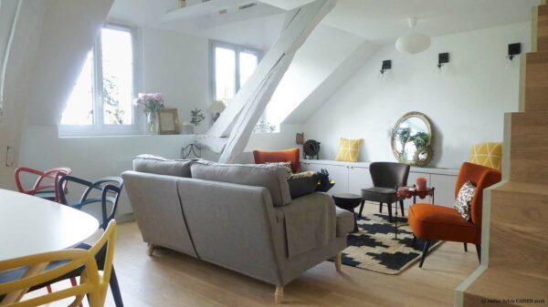 Atelier Sylvie Cahen Architecte Intérieur Paris 12 éme choisy paris pratique fonctionnel design contemporain tendance salon poutre escalier bois parquet canapé gris fauteuil orange Kartell
