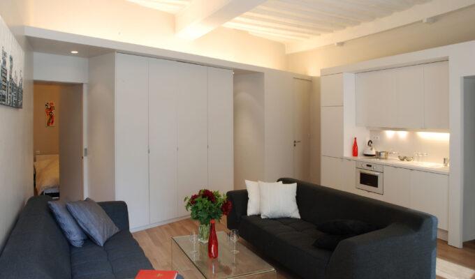Turennes appartement Paris volume ligne placard rangment sur mesure meuble structurant comtemporain dissimuler cacher voir cuisine salle de bain poutre apparente